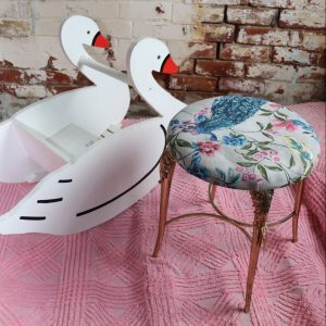Swan and brass chair